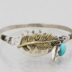 Burnished gold & silver boho leaf bracelet New! Burnished silver tone 2.25 inch diameter hook bracelet. Bundle and save 15%. No trades. Jewelry Bracelets