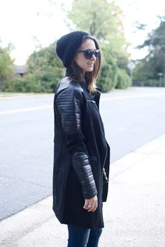 Biker style black coat with leather sleeves