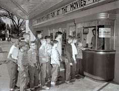 SATURDAY TRADITION - Young boys line-up to purchase movie tickets at their neighborhood theatre box office - 1957.