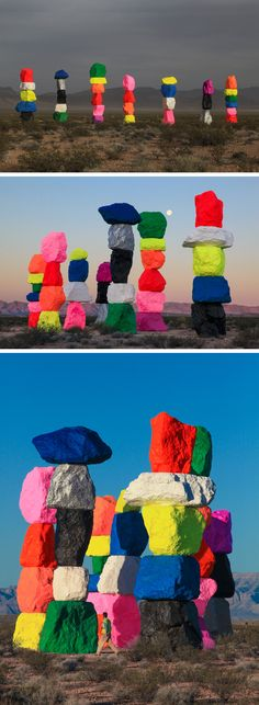 "sculpture abstraite US : Ugo Rondinone, 2016, ""Seven 30-Foot-Tall Dayglow Totems"", désert du Nevada, art environnemental, multicolore, pierres, rochers, 2010s"