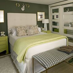 Fresh Green Different shades of green make crisp white bedding and accessories pop. Luxurious layered flooring grounds the space with exaggerated textures.