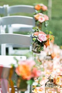 orange/coral ceremony aisle flowers by passion roots