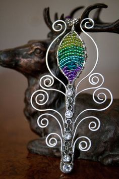 Handmade beaded wire wrap peacock feather pendant by ErinMalaspino, $35.00