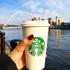 Starbucks coffee with a view . #newcastle #england #best #city #quayside #river #starbucks #hazelnutlatte #coffee #coffeelover #obsessed #beautiful #view #cloudy #sky #