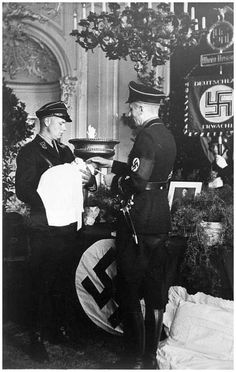 The Nazi ritual: Baptism of a child born to a Lebensborn member, Germany