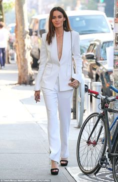 She means business! Model Nicole Trunfio took the plunge in tailored two piece white suit as she stepped out in New York City on Saturday