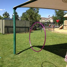 Great activity for themed days! Hang a hoola hoop with yarn from poles on the play ground. Cut noodles in half and let kids pretend they are shooting bows and arrows through the target with the pool noodles. We used this for western day and called it snakes in the hole! Can also be used for Olympic week!