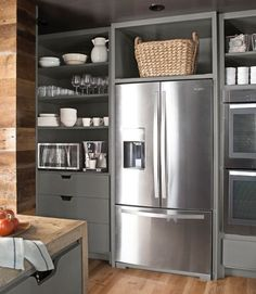 In a small kitchen, open cabinets aren't just for show. You want as few swinging doors as possible.     #kitchen #decorating ideas by Dreamin of projects