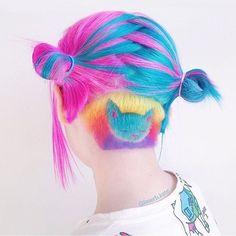Bright multi coloured hair with cat design @laserb.kate