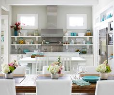 Fresh and pretty white kitchen with pops of color in accessories.