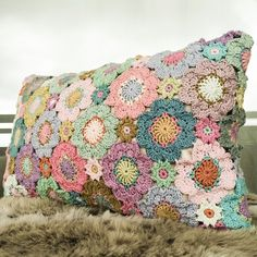 My finished flower pillow, picture taken in the oddest light.
