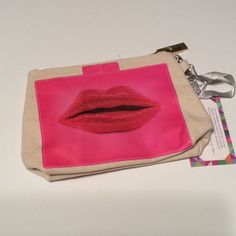 Makeup bag clutch statement wristlet How. It's is this!!!! Super cute little bag that you can use as a makeup bag, clutch, wristlet, or more! Has lips screen printed on both sides.  Canvas bag.  Red.  Rough measurements are 8x5 NWT Boutique Bags