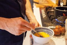 Chef Tom Aikens at work in the kitchen of his home, located in Chelsea, London.
