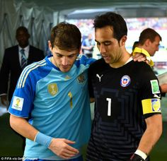 One to one: Chile goalkeeper Claudio Bravo talks to Iker Casillas after the game...