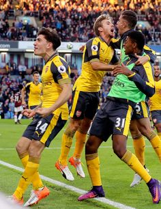Arsenal players celebrate their last minute winner during the Premier League match between Burnley and Arsenal at Turf Moor on October 2, 2016 in Burnley, England.