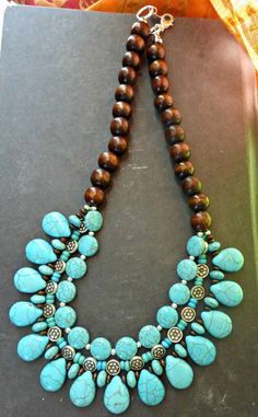 Turquoise stone, wood and silver metal beaded necklace. Bohemian handmade…