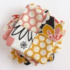 Learn to make these easy fabric coasters for a hostess gift or for yourself. CUTE!