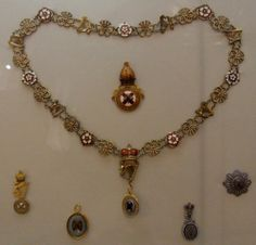 Order of St Patrick regalia, Ulster Museum, Including a breast badge, prelate's badge, officer's badge and star badge.