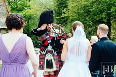 Kate & Ross' day was made when a surprise bag piper arrived in the grounds