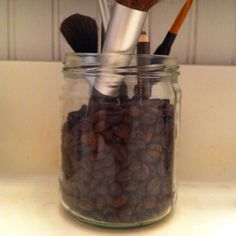 Jar full of coffee beans for my make-up brushes. *Bonus -it's smells good!