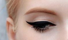 I love how despite the amazing cat eye.. the mascara, penciled in eyebrows, and blush make the look.