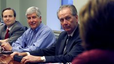 After Bottling Michigan's Clean Water, Nestle Comes Under Fire For Ties To Snyder Admin -  Feb 3, 2016 -  Michigan Gov. Rick Snyder, center, meets with senior staff to begin his first morning as governor, his chief of staff Dennis Muchmore, right. is married to Nestle's Michigan spokesperson Deb Muchmore. Jan. 3, 2011, in Lansing, Mich. (AP Photo/Al Goldis)