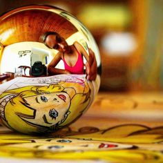 Coloring princess. #vivid #colors #colorful #reflection #sphere #girl #yellow #goldhair