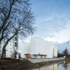 Álvaro Siza Vieira's use of light and white concrete provides a unique ceremonial space for the Church of Saint-Jacques-de-la-Lande, that gently folds into the neighborhood south of Rennes, France. Brittany France, Work Images, Saint Jacques, White Concrete, Cemetery, Swimming Pools, Restoration, Brick, Saints