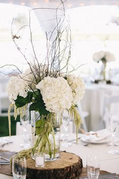 Rstic White Hydrangea and Tree Stump Wedding Centerpiece