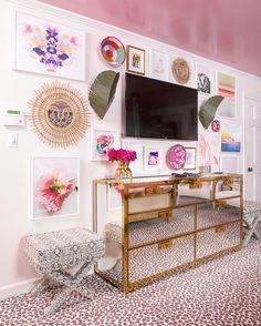 I can't seem to do a @oneroomchallenge without a gallery wall. This crazy wall was to distract from the ginormous tv that @marshallpclt wanted. I figured if I can have a pink floral bedroom he can have his . Gallery wall goodness from @minted @hapiart @shopcandelabra @framebridge @lesleygrainger @katelongstevenson. Chest by @bernhardtfurniture Savanna Scenes carpet by @karastancarpet. Full Gloss pink ceiling in Nancy's Blushes by @farrowandball. Palm sconces by @varaluz #design…