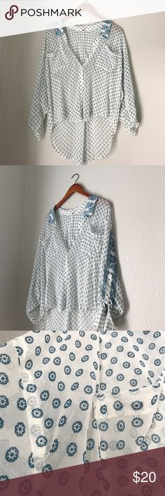 Free People boho blouse Adorable Free people button up blouse. slightly shorter in the front than the back. Sleeve ties with buttons. Please note: right pocket- run in fabric. Accepting offers! Free People Tops Button Down Shirts