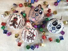Three designs for circularly-knit, ball-shaped Christmas ornaments with stranded knitting motifs repeated across all