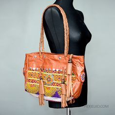 Big boho colourfull handmade bag made of brown soft sheep leather, decorated with tassels, ethnic embroidery and beads patches. The handbag has zipper. Perfect for girls or women who like boho style.  Handmade in Pakistan  Dimensions: 36 x 28 x 10 cm  I have more avalaible items in piekielkoetnojewelry.etsy.com
