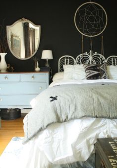 moody boho bedroom - love the dark walls with the white bedding and all of her vintage finds!