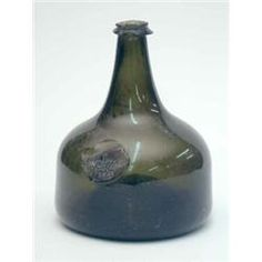 A George I sealed wine bottle, onion shape with high basal kick, seal named Welman and dated 1723...