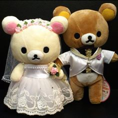 Rilakkuma and Korilakkuma bride and groom plushies.