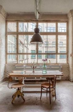 light window, i would use a dark table, maybe a vintage table with scroll legs, painted with chalk board paint.