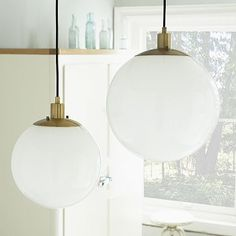 "West Elm Globe Pendant in Milk Finish ($99-$129) - Love the ""milk finish"" with the brass base. Affordable version of a classic design."