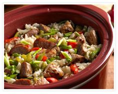 Cajun Sausage Jambalaya - 1 pound boneless pork loin roast, cut into 1/2-inch cubes, lean, 12 ounces andouille sausage, cut into 1/4-inch slices, 2 1/2 cups water, 1 1/2 cups rice, medium-grain white, 2 yellow onions, chopped, 1 bell pepper, (green, red, or both), chopped, 2 stalks celery, chopped, 2 tablespoons vegetable oil, 1 1/2 teaspoons salt, 1/4 to 1/2 teaspoon cayenne pepper, 1/2 cup green onions, chopped.