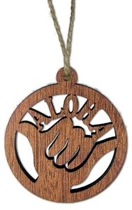 Hawaiian Wood Christmas Ornament. Add this ornament to your collection to bring the Island spirit to your home for the holidays. Measures approximately 3 inch diameter.
