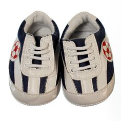 Casual blue denim coloured shoe with white and red stripes and soccer ball motif on the side. Pre-walker sneaker for boys with white laces to keep little feet in. Sneakers are ankle high with a non-slip sole to provide grip to surfaces if your little boy crawls, stands or takes a couple of steps. Shoes are made of material and a soft sole making the shoes lightweight and easy to wear.       Price: $29.95  http://www.bubbaboosh.com.au/boys-shoes/Flynn