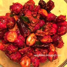 Pickled Cranberry (Cranberry Vuragaya ): Tangy cranberries mixed with spicy powders then seasoned perfectly to create a mouthwatering fresh pickle.Have with Rice, clarified butter or on the side with Roti/Naan.