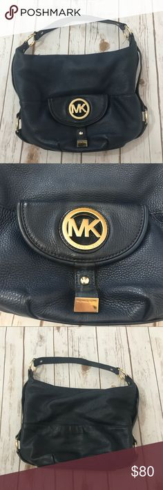 """MICHAEL KORS LEATHER NAVY BLUE PURSE Excellent used condition, leather Michael KORS purse with gold hardware.  A few pen marks on the inside otherwise like new.    Across- 15"""" Width - 6"""" Height - 11.5"""" - POSH AMBASSADOR - FAST SHIPPER - SOLD 120+ ITEMS - 5 STAR SELLER - SMOKE FREE, CLEAN HOME - I TAKE PRIDE IN EVERY ITEM I SHIP OUT Michael Kors Bags Shoulder Bags"""