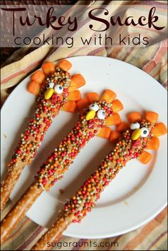 Make a turkey pretzel rod snack with the kids for a cute Thanksgiving snack.  They are almost too cute to eat! Almost.