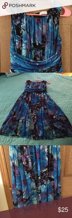 Gorgeous turquoise and purple dress. This is a re-posh. Unfortunately too small for me. The tag isn't on the dress, but posher said it is a 4. Very pretty dress Calvin Klein Dresses Midi