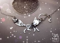 Hand cut out  and upcycled silver curious fox necklace made from silver coins