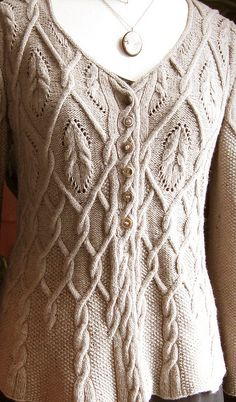 Cables, lace, cardigan.