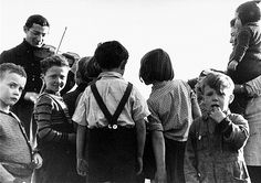 Violinist playing for children in KZ Westerbork, The Netherlands.