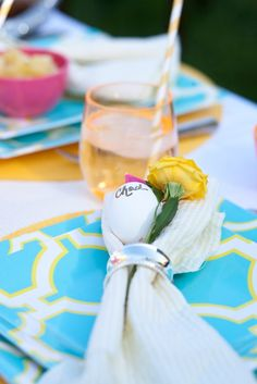 Easter Brunch- name card is a hard boiled egg with name on it & flower