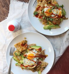 Green Chilaquiles - Mexican dish where salsa is poured over fried tortilla and topped with fried eggs.
